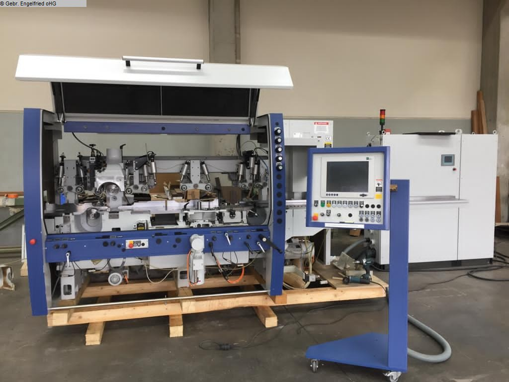 used 4 side moulder WEINIG Powermat 500 m. Mechanisierung