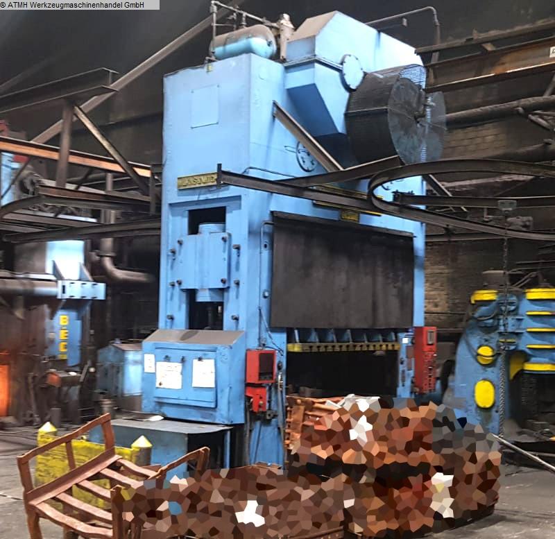 gebrauchte Pressen und Bördelmaschinen Abgratpresse WILKINS & MITCHELL 1000 T